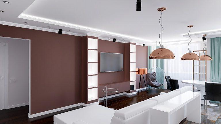 квартира студия в оттенках древесного цвета, подвесные светильники cooper за диваном, подвесное кресло
